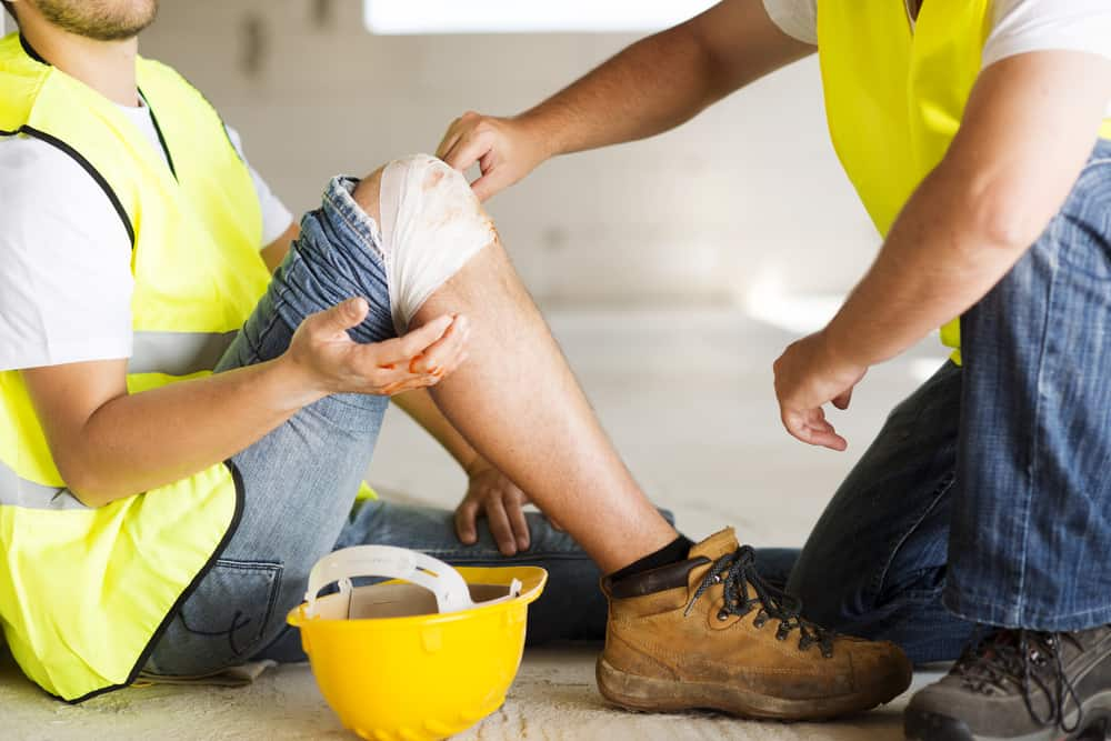 construction worker holding on to injured knee
