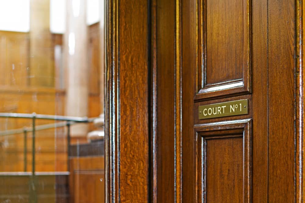 door to the court room of a workers compensation hearing