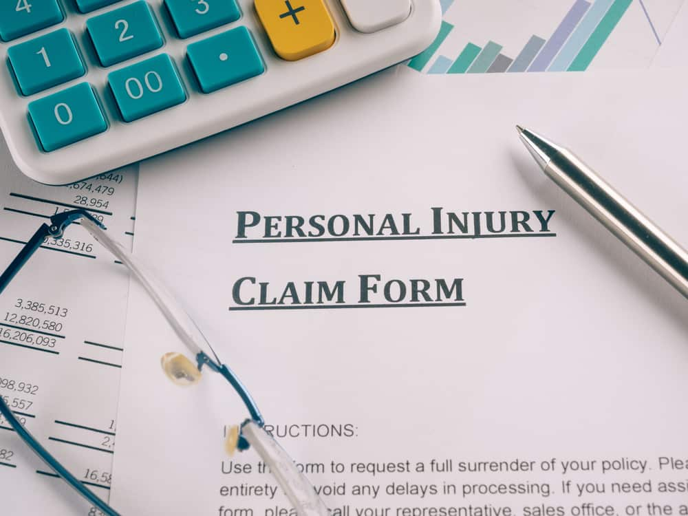 """personal injury claim form"" written on document"